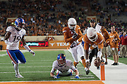 AUSTIN, TX - NOVEMBER 7:  Tyrone Swoopes #18 of the Texas Longhorns recovers a fumble 10 yards for a touchdown against the Kansas Jayhawks during the 4th quarter on November 7, 2015 at Darrell K Royal-Texas Memorial Stadium in Austin, Texas.  (Photo by Cooper Neill/Getty Images) *** Local Caption *** Tyrone Swoopes