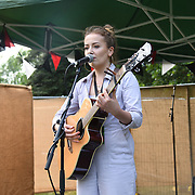 Mia Grace a solo singer performs at the Food Market at Kew the Music 2019 on 10 July 2019, London, UK.