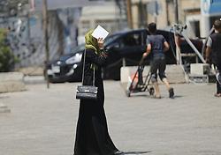 July 8, 2017 - Gaza City, The Gaza Strip, Palestine - A Palestinian girl walking on a hot day in Gaza City. (Credit Image: © Mahmoud Issa/Quds Net News via ZUMA Wire)