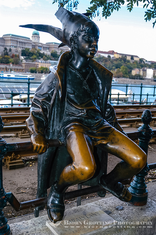 Budapest, Hungary.  Kiskiralylany, a bronze elf, sitting on the Pest side of Budapest. Also known as Little Princess.