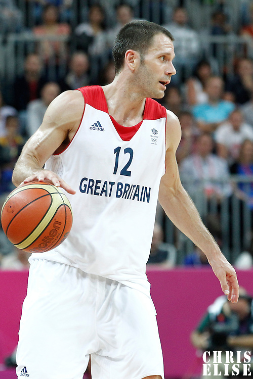 31 July 2012: Great Britain Nate Reinking sets the offense during 67-62 Team Brazil victory over Team Great Britain, during the men's basketball preliminary, at the Basketball Arena, in London, Great Britain.