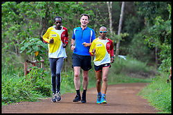 May 3, 2019 - Nairobi, Nairobi, Kenya - Image ©Licensed to i-Images Picture Agency. 03/05/2019. Nairobi, Kenya. Jeremy Hunt Africa Tour Day Six. The Foreign Secretary Jeremy Hunt running with Kenyan athlete Henry Wanyoike (Sun Glasses) and his guide Paul Wanyoike, in Karura Forest, Nairobi, Kenya, on the final day of his six day tour of Africa. (Credit Image: © Andrew Parsons/i-Images via ZUMA Press)