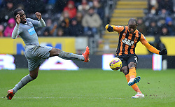 Hull City's Sone Aluko is challenged by Newcastle United's Vurnon Anita - Photo mandatory by-line: Richard Martin-Roberts/JMP - Mobile: 07966 386802 - 31/01/2015 - SPORT - Football - Hull - KC Stadium - Hull City v Newcastle United - Barclays Premier League