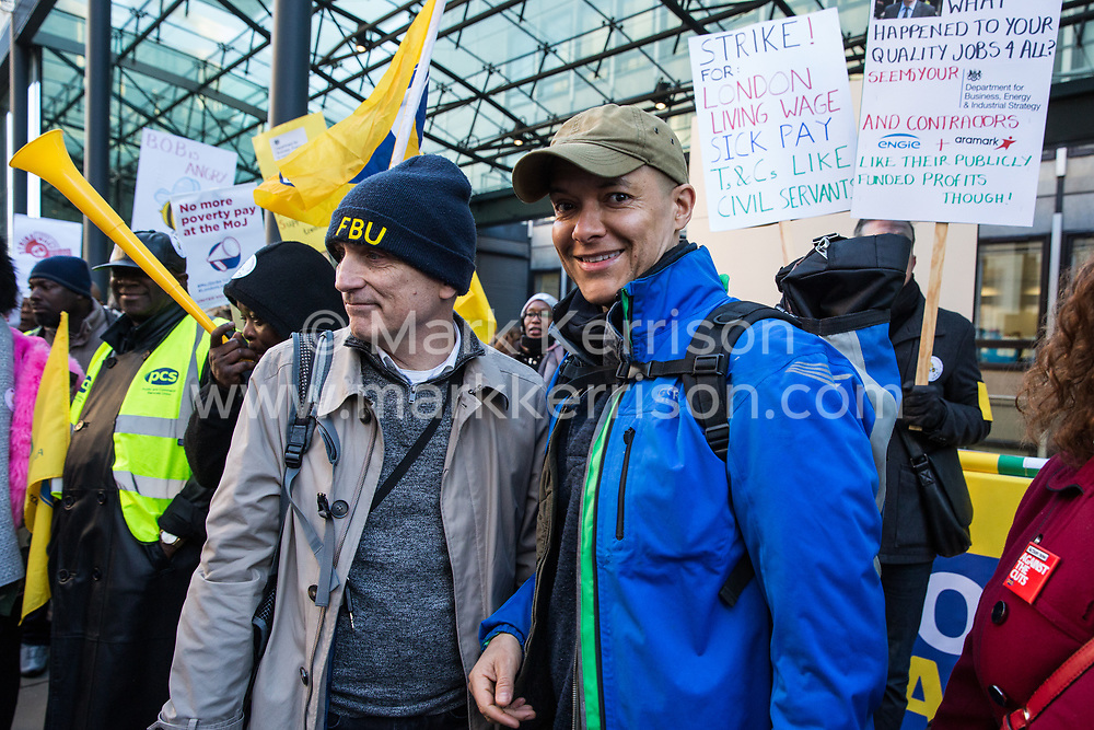 London, UK. 22nd January, 2019. Chris Williamson, Labour MP for Derby North, and Shadow Minister for Sustainable Economics Clive Lewis shows solidarity with support staff at the Department for Business, Energy and Industrial Strategy (BEIS) represented by the Public and Commercial Services (PCS) union on the picket line after beginning a strike for the London Living Wage of £10.55 per hour and parity of sick pay and annual leave allowance with civil servants. The strike is being coordinated with receptionists, security staff and cleaners at the Ministry of Justice (MoJ) represented by the United Voices of the World (UVW) trade union.