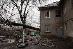 The apartment block in Debaltsevo where Nina Prokopenko looks after her husband Ivan. In February their neighbourhood was the scene of fierce fighting and they struggled to survive four days of continuous shelling that destroyed the roof of their apartment block and set fire to parts of the building. Trapped inside, they endured the horrors which have left them both traumatised and Ivan depressed to the point of being unable to go outside or take care of himself. Dr Svetlana Niekurasa, working with the MSF home visits team has returned to visit Nina and Ivan for a second time to check up on his condition and to bring medication which is unavailable in the city since the conflict began.