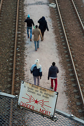 © Licensed to London News Pictures. 12/08/2015. Calais, France. Migrants attempt to access the train tracks to the Eurotunnel terminal at Frethun near Calais, northern France on August 12th, 2015. Photo credit: Ben Cawthra/LNP