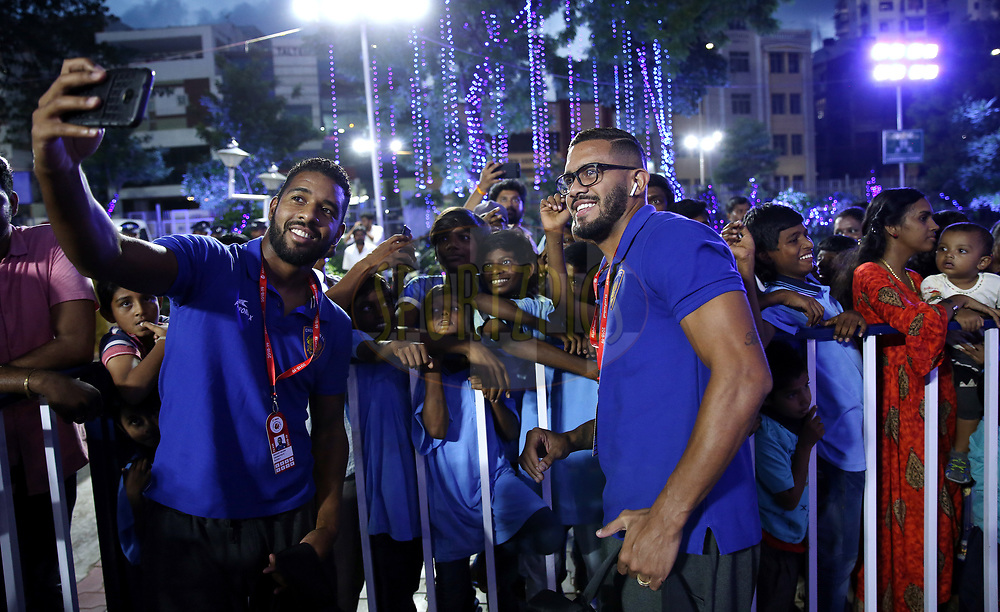 Gregory Nelson of Chennaiyin FC and Raphael Augusto of Chennaiyin FC meets the Dazzlingstone Orphanage Kids during match 27 of the Hero Indian Super League 2018 ( ISL ) between Chennaiyin FC  and Mumbai City FC  held at the Jawaharlal Nehru Stadium, Chennai, India on the 3rd November 2018<br /> <br /> Photo by: Sandeep Shetty /SPORTZPICS for ISL