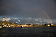 Rainbow over town of Dingle, County Kerry, Ireland