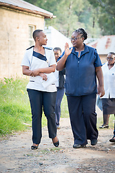 """2 March 2017, Morija, Maseru district, Lesotho: Gwendolyn (right) and Malika (left) are nurses at Scott Hospital, where they've worked for 10 and 8 years, respectively. Both studied at Maluti Adventist Hospital. Scott Hospital is run by the Lesotho Evangelical Church in Southern Africa and is a founding member of the Christian Health Association of Lesotho. It is located in the village of Morija, and operates and supervises clinics in the Maseru District of Lesotho. Scott started out as a dispensary in 1864, and today offers comprehensive healthcare Mondays-Fridays, as well as pharmaceutical services around the clock. Lesotho suffers from high numbers in Tuberculosis in disesase and mortality, and so the hospital screens all patients for TB. The hospital observes among many patients what they describe as """"low health-seeking behaviour"""", services are increasing and demand rising, but space and human resources are a challenge, as is funding. I key concern is one of infrastructure, where the original design of the hospital matches poorly with current needs, as departments and buildings are scattered, posing a challenge for security. Another challenge is to adapt donation structures, so as to be able to receive payments electronically. The hospital has one ambulance, which they describe as not enough, but what they have. Another challenge is that lack of funds affects maintenance of buildings and infrastructure, as the immediate care of patients take priority. PLEASE NOTE: This photo is not to be used in social media."""