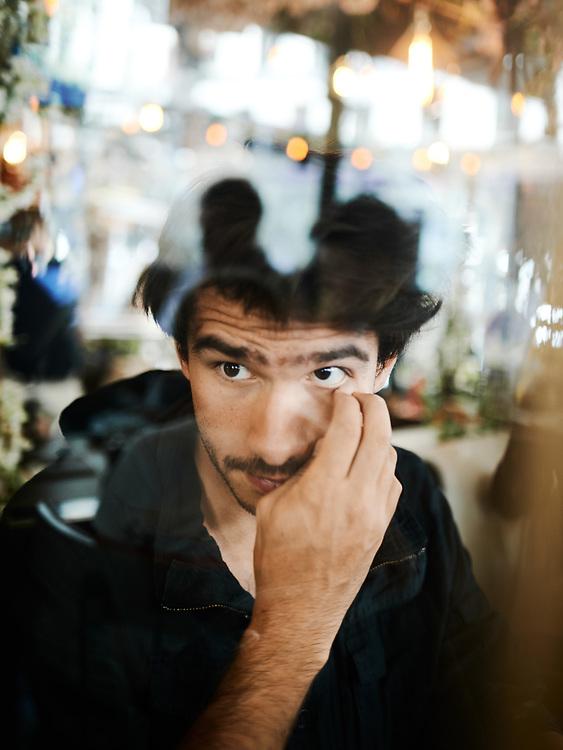 Juan Branco, lawyer, journalist, writer, posing at the Cafe Cassette. Paris, France. July 2, 2019.<br /> Juan Branco, avocat, journaliste et ecrivain, posant au Cafe Cassette. Paris, France. 2 juillet 2019.