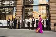 Lead dancer Jessica Grippo walks by a line of ogling men.