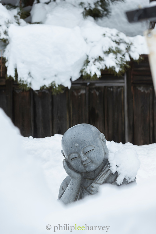 Close-up of statue covered in snow, Yudanaka Onsen
