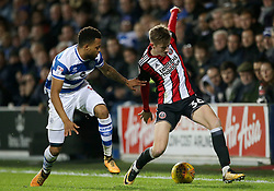 Sheffield United's David Brooks and Queens Park Rangers' Jordan Cousins in action during the game during the Sky Bet Championship match at Loftus Road, London.