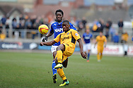 Chesterfield's Armand  Gnanduillet challenges Newport's Deji Oshilaja. Skybet football league two match, Newport county v Chesterfield at Rodney Parade in Newport, South Wales on Sunday 1st Dec 2013. pic by Andrew Orchard, Andrew Orchard sports photography,