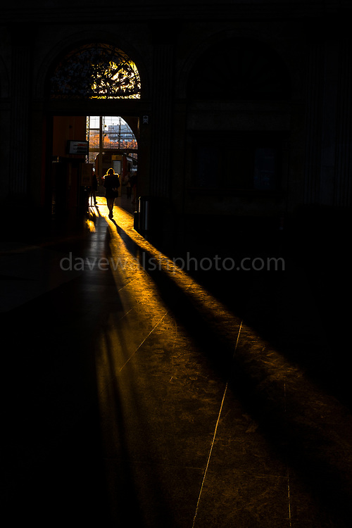 "Long winter shadows fall in the entrance hall of Estació de França, railway station, Barcelona, December 2017. This mage can be licensed via Millennium Images. Contact me for more details, or email mail@milim.com For prints, contact me, or click ""add to cart"" to some standard print options."