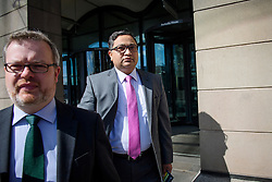 ©  London News Pictures. 28/04/2016. London, UK. BIMLENDRA JHA, CEO of TATA Steel (right), leaves Portcullis House in London after giving evidence to the Commons Business Committee on the future of British steel. TATA Steel. The future of Tata Steel has been in doubt since it announced it would sell its loss-making UK business. Photo credit: Ben Cawthra/LNP