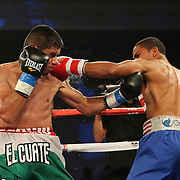 ORLANDO, FL - OCTOBER 04:  Felix Verdejo of Puerto Rico (R) and Sergio Villanueva of Mexico trade punches during their professional lightweight boxing match at the Bahía Shriners Auditorium & Events Center on October 4, 2014 in Orlando, Florida. Verdejo won by a TKO in the third round. (Photo by Alex Menendez/Getty Images) *** Local Caption *** Felix Verdejo; Sergio Villanueva