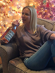 """Katherine Heigl releases a photo on Twitter with the following caption: """"""""You know what's more than awesome + guaranteed to usher in all the holiday cheer? A giant bottle of delicious rosè sent by @BookSparks as a belated b-day gift. To be clear I'm not sharing... Thank you! I'm off to enjoy my rosè & the next great book from our list of favs! #FRC2018"""""""". Photo Credit: Twitter *** No USA Distribution *** For Editorial Use Only *** Not to be Published in Books or Photo Books ***  Please note: Fees charged by the agency are for the agency's services only, and do not, nor are they intended to, convey to the user any ownership of Copyright or License in the material. The agency does not claim any ownership including but not limited to Copyright or License in the attached material. By publishing this material you expressly agree to indemnify and to hold the agency and its directors, shareholders and employees harmless from any loss, claims, damages, demands, expenses (including legal fees), or any causes of action or allegation against the agency arising out of or connected in any way with publication of the material."""