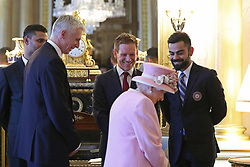 Queen Elizabeth II meets England cricket captain Eoin Morgan (centre), Bangladesh captain Masrafe Bin Mortaza (left) and India captain Virat Kohli (right). The captains of the teams taking part in the ICC Cricket World Cup meet for a photograph in the 1844 Room at Buckingham Palace in London, ahead of the competition's Opening Party on the Mall.