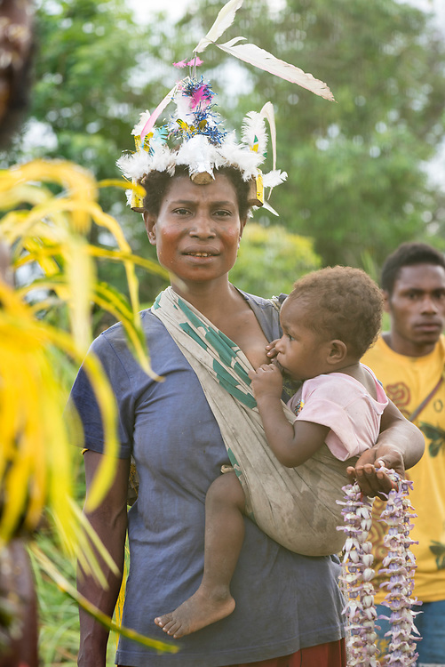 A Mbore woman, dressed to celebrate the Mborena Kam New Testament dedication, nurses her child on July 26, 2017, in Madang Province, Papua New Guinea. The work to translate the New Testament into this language, one of more than 800 in Papua New Guinea, took over 30 years.