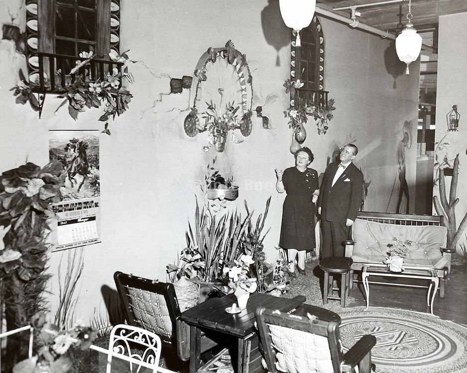 inspecting the decoration before the annual factory party USA 1940s