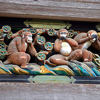 "Asia, Japan, Nikko. Carved wood detail of the three monkeys representing ""Hear no evil, speak no evil, see no evil"" at the Toshogu Shrine and mausoleum in the forest of Nikko."