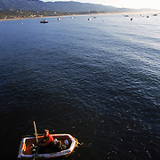 A man rowing raft in the Pacific Ocean off the coast of Santa Barbara, California.