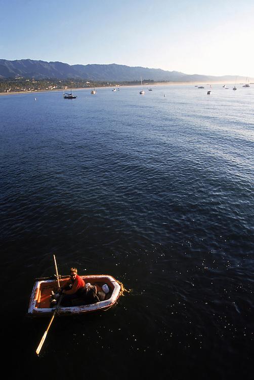 A man rowing raft in the Pacific Ocean off the coast of Santa Barbara, California.