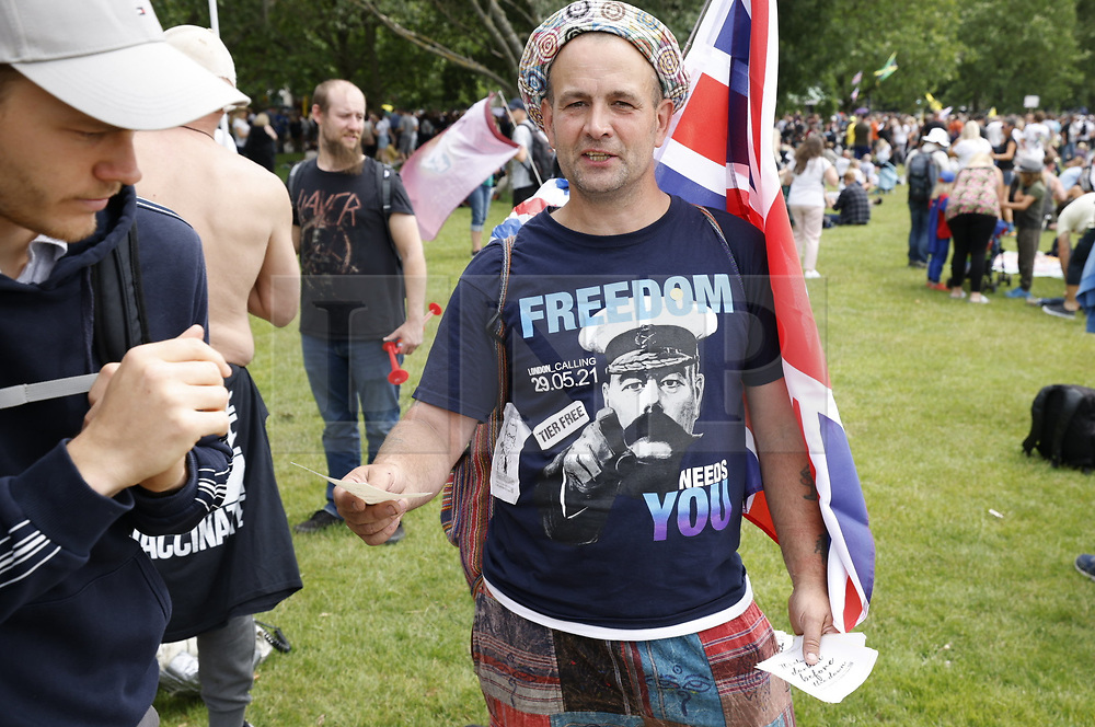 © Licensed to London News Pictures. 26/06/2021. London, UK. Anti-lockdown protesters gather in Hyde Park, central London. Various groups are marching in central London today calling for freedom and an end to lockdown regulations. Photo credit: Peter Macdiarmid/LNP