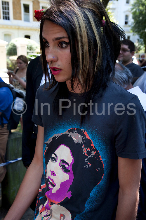 """Brandon Hayward (16) a loyal and deeply upset and distressed Amy Winehouse fan at the memorial opposite the home of Amy Winehouse, Camden Square, North London. In signature make up and wearing a t-shirt of her image, he said """"It's destroyed me. It's killed me. We hadn't seen too much of her in the press recently so thought things were alright, and now this, she's died. I don't know what to do, how I can make it better."""" Brandon had first seen Winehouse at his first ever gig just aged 12 years old. It was announced that the tragic singer had died on 23rd July 2011. The music world has been paying tribute to singer Amy Winehouse, 27, who was found dead at her London home following years of drug and alcohol abuse largely attributed to her troubled character and fame."""