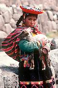 PERU, PORTRAITS a young Quechua girl and her lamb at Tambo Machay, the ancient Incan Royal Baths near  Cuzco