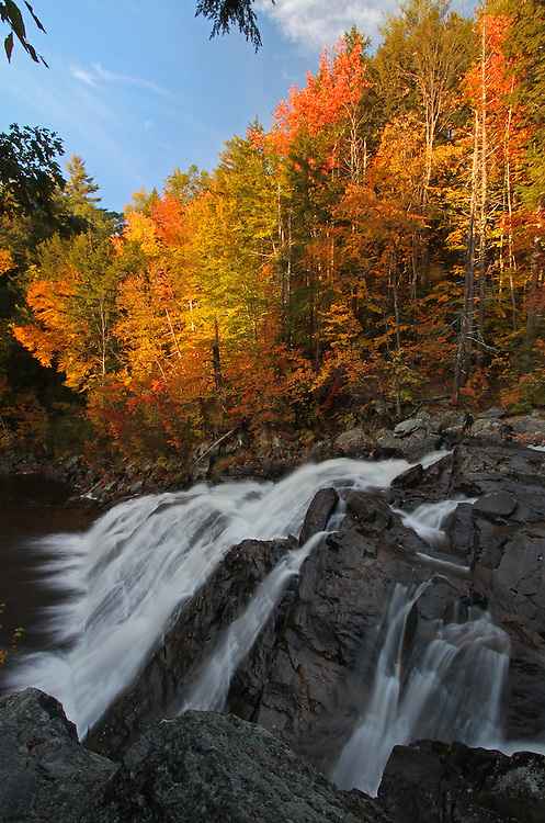 Landscape photography images of this glorious waterfall autumn scenery at Profile Falls in New Hampshire are available as museum quality photography prints, canvas prints, acrylic prints or metal prints. Prints may be framed and matted to the individual liking and decorating needs:<br /> <br /> http://juergen-roth.artistwebsites.com/featured/profile-falls-juergen-roth.html<br /> <br /> New England waterfall photography of Profile Falls off NH Route 3A near Bristol and the White Mountains region photographed during New England fall foliage peak colors in October. This view shows Profile Falls with the cascades  above the falls.<br /> <br /> Good light and happy photo making!<br /> <br /> Juergen <br /> Prints: www.RothGalleries.com<br /> Licensing: www.ExploringTheLight.com<br /> Photo Blog: http://whereintheworldisjuergen.blogspot.com<br /> @NatureFineArt