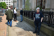 Man wearing a t-shirt for the heavy metal band Obituary in Birmingham, United Kingdom.
