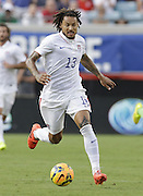 JACKSONVILLE, FL - JUNE 07:  Midfielder Jermaine Jones #13 of the United States dribbles during the international friendly match against Nigeria at EverBank Field on June 7, 2014 in Jacksonville, Florida.  (Photo by Mike Zarrilli/Getty Images)