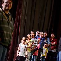 051414       Cable Hoover<br /> <br /> Students watch members of the Gallup High School drama club demonstrate a scene during an improv class at El Morro Theatre Wednesday.