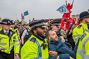 Police make arrests on Waterloo Bridge and are pointed at by performers repesenting the blood of species that will become extinct. It is mostly good humoured but some are dragged away to cheers from the remainder -  Day 2 - Protestors from Extinction Rebellion block several (Hyde Park, Oxford Cuircus, Warterloo Bridge and Parliament Square) junctions in London as part of their ongoing protest to demand action by the UK Government on the 'climate chrisis'. The action is part of an international co-ordinated protest.