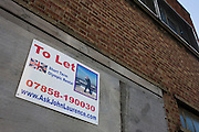 A To Let sign attached to the wall of a vacant building offering space near to the 2012 Olympic Park site.