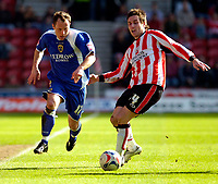 Photo: Alan Crowhurst.<br />Southampton v Cardiff City. Coca Cola Championship. 01/04/2006. Cardiff's Kevin Cooper challenges with Jim Brennan.