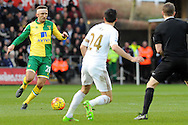 Norwich's Gary O'Neil (l) goes on the attack. Barclays Premier league match, Swansea city v Norwich city at the Liberty Stadium in Swansea, South Wales on Saturday 5th March 2016.<br /> pic by  Carl Robertson, Andrew Orchard sports photography.
