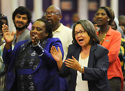 The City of Cape Town hosted an Evening of Remembrance at the OR Tambo hall, Khayelitsha. for the late former President of South Africa, Nelson Mandela. MILDRED OLIPHANT, Minister of Labour, and the Executive Mayor of Cape Town, PATRICIA DE LILLE, sing struggle songs, South Africa  Monday, 9th December 2013. Picture by Roger Sedres / i-Images