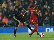 Angel Correa of Atletico Madrid tackled by Sadio Mane of Liverpool  during the UEFA Champions League match at Anfield, Liverpool. Picture date: 11th March 2020. Picture credit should read: Darren Staples/Sportimage