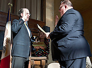 District 3 Council Member Pat Shey (left) repeats the oath of office with Pat Kane (right), diaconal minister with Crossroads Mission, as his daughter, Caroline Shey, 11, (center) holds a bible at the Cedar Rapids mayor and city council swearing in ceremony at the Veterans Memorial Building in Cedar Rapids on Saturday January 2, 2010. (Stephen Mally/Freelance)