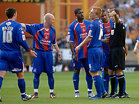 Photo: Glyn Thomas, Digitalsport<br /> Wolverhampton Wanderers v Crystal Palace. Coca Cola Championship. 09/08/2005.<br /> Palace players remonstrate with referee Rob Styles (R) after he disallowed a goal for the London team.