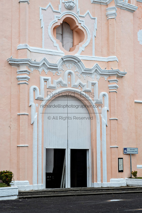 The brightly painted Caribbean style Sanctuary of Our Lady of Candlemas church in Tlacotalpan, Veracruz, Mexico. The tiny town is painted a riot of colors and features well preserved colonial Caribbean architectural style dating from the mid-16th-century.