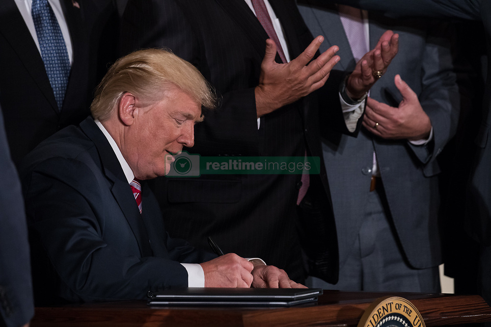 June 5, 2017 - Washington, DC, United States - Rep. Bill Shuster (R-PA), Chairman, House T&I Committee, asked President Donald Trump to autograph some cards for him, after POTUS signed a letter of principal that would privatize  the air traffic control functions of the Federal Aviation Administration, in the East Room of the White House, on Monday, June 5, 2017. (Photo by Cheriss May) (Credit Image: © Cheriss May/NurPhoto via ZUMA Press)