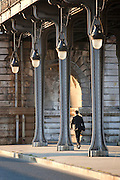 The walkway on the lower floor of Pont de Bir-Hakeim, a steel bridge crossing the River Seine in Paris, France. The upper level is a railway for the cities metro system.
