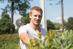 Young man working in urban garden, Freiburg im Breisgau, Baden-Wuerttemberg, Germany