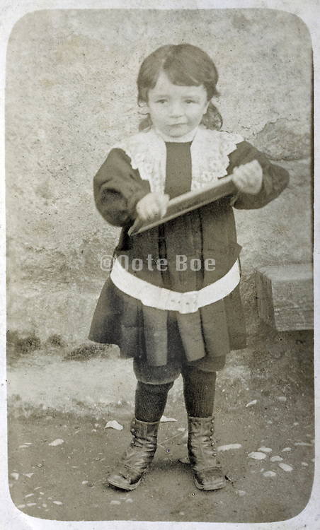 schoolchild with a small personal chalkboard France