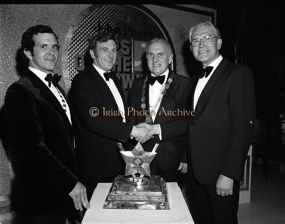 """Tops of the Town Final.   (N79)..1981..31.05.1981..05.31.1981..31st May 1981..The John Player sponsored Tops Of The Town competition had its final tonight in the Gaiety Theatre, Dublin.The overall winners were the Limerick Insurances Group...Image shows Mr Oliver Casey (right),Managing Director,John Player presenting the john Player """"Tops of the Town Award'to the producer of the winning Limerick Insurances group, Mr Douglas Howell. Included in the photograph are Mr Sam McCrum,(left), President of the Insurance Institute of Limerick and Clr Clem Casey, Lord Mayor of Limerick."""