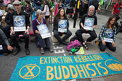 Extinction Rebellion Buddhists take part in the first day of Impossible Rebellion protests on 23rd August 2021 in London, United Kingdom. Extinction Rebellion are calling on the UK government to cease all new fossil fuel investment with immediate effect. (photo by Mark Kerrison/In Pictures via Getty Images)
